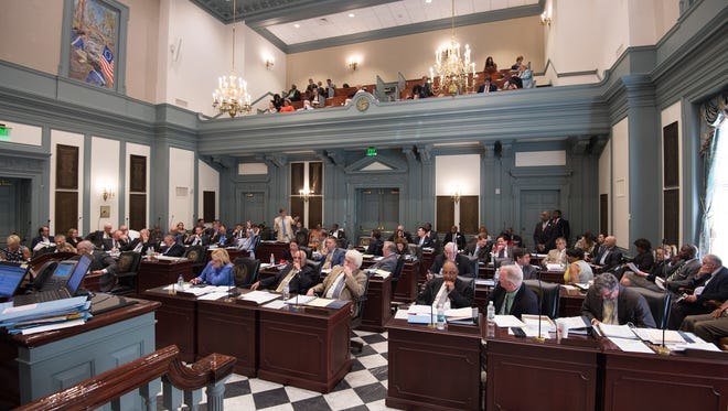 Delaware lawmakers attend a session at the Statehouse in Dover on June 22. Presumptive Democratic presidential nominee Hillary Clinton has said she plans to get the polarizing Citizens United campaign fundraising decision overturned.