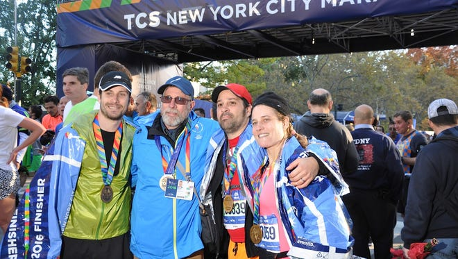 From left, Greg, Dennis and Tim Fulton, and Amy Fulton Eades, at the finish of the 2016 New York City Marathon