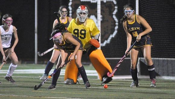 Pelham players watch Brewster shot go wide right. Photo