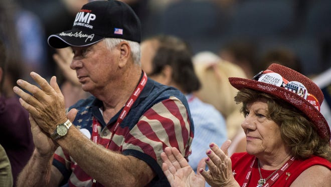Indiana State Sen. Jim Tomes, left, and his wife Margie applaud during the Indiana Republican State Convention at the Ford Center on Saturday, June 9, 2018.