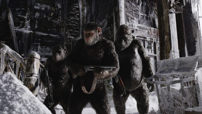 "Caesar (center, Andy Serkis via motion capture) leads a group including Rocket (Terry Notary) and Luca (Michael Adamthwaite) on a mission of revenge in ""War for the Planet of the Apes,"" in theaters July 14."