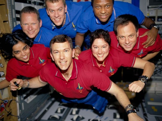 Space shuttle Columbia crew members strike a flying pose for their traditional in-flight crew portrait in the research lab aboard the shuttle in January 2003. Clockwise from left are Kalpana Chawla, David M. Brown, William C. McCool, Michael P. Anderson, Ilan Ramon, Laurel B. Clark, and Rick D. Husband. All seven crew members died Feb. 1, 2003, when the Columbia broke up over North Texas during re-entry.