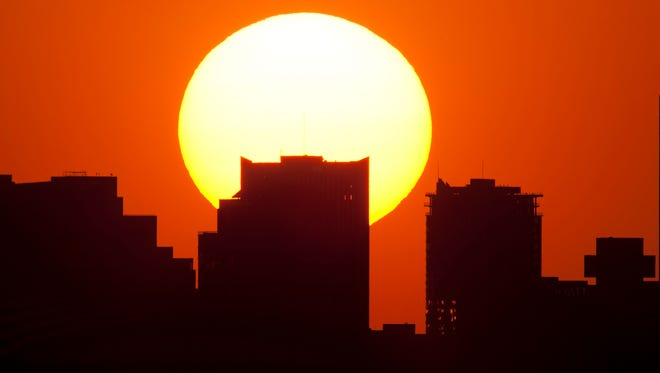 The sun sets over downtown Phoenix in June 2011.