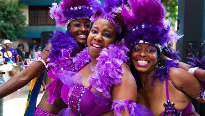 Caribbean dancers show off their lavish costumes at the Caribbean Carnival Village at Park Central Mall on May 26, 2014.