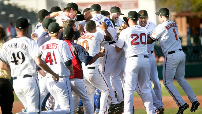 The Saguaros celebrate after defeating the Solar Sox 2-0 to win the Arizona Fall League championship game.