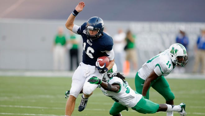 Rice Owls quarterback Taylor McHargue (16) runs the ball against the Marshall Thundering Herd in the fourth quarter at Rice Stadium.