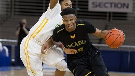Arcadia guard Travious Fielding signed with Grambling on Wednesday as part of the Tigers' 2016 signing class.