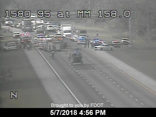 A helicopter landed on Interstate 95 to transport a