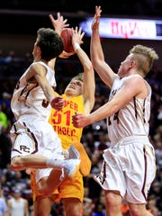 Jacob Schaefer of of Kuemper Catholic is fouled as he drives to the basket in the 2A semifinal game against Pella Christian Thursday, March 9, 2017.