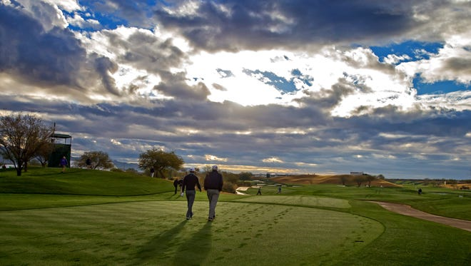 Tiger Woods (left) walks with Andy North during a practice round on Jan 27, 2015, for the Waste Management Phoenix Open at TPC Scottsdale.