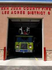 San Juan County Fire Department District 6 Fire Chief Chad Vecellio on Monday parks a fire truck in the station's garage in Farmington.