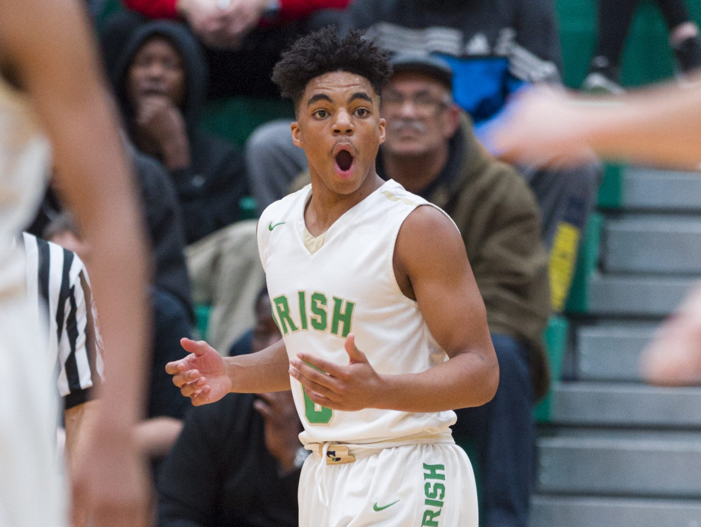 Cathedral High School sophomore James Franklin (0) reacts to being called for traveling during the first half of the Indianapolis City Boy's Basketball Tournament championship game Monday, Jan. 23, 2017, at Arsenal Tech High School.