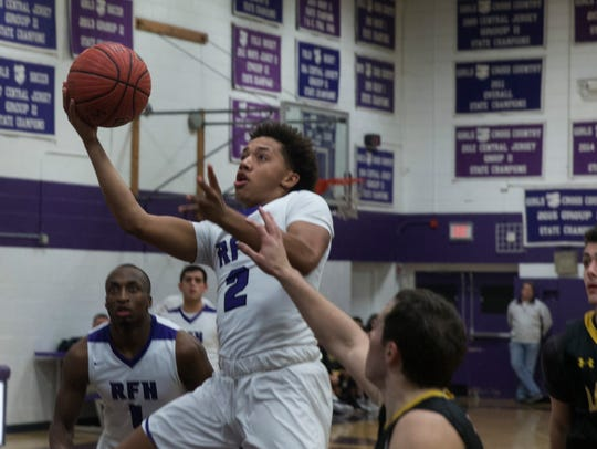 Rumson-Fair Haven's Devin Cooper take a shot versus St. John Vianney on Jan. 16, 2018. Photos by Peter Ackerman
