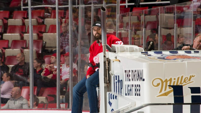 Tigers pitcher Michael Fulmer rides the Zamboni between the second and third periods of a Red Wings game Wednesday.