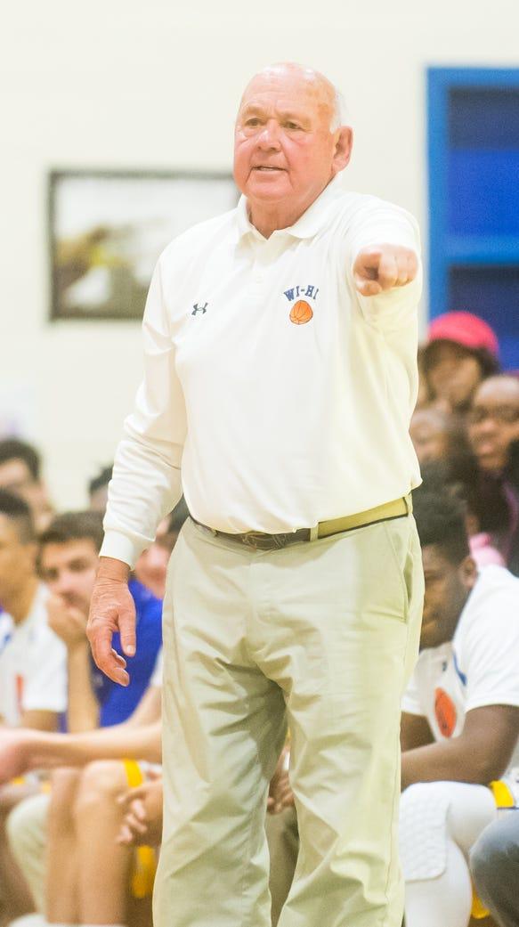 Wicomico High head coach Butch Waller moves his team