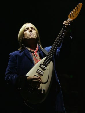 Tom Petty and his band the Heartbreakers perform at