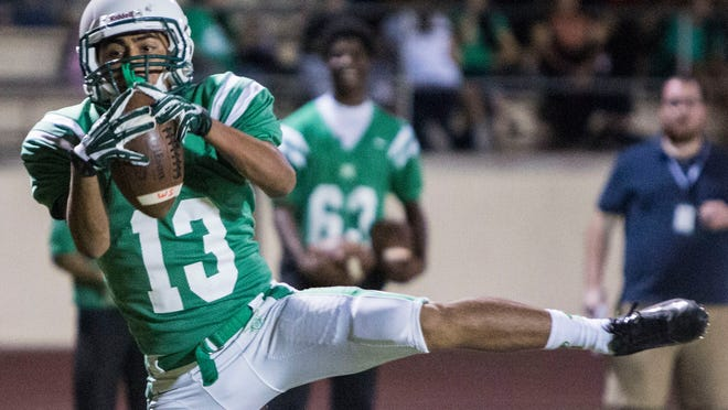 St. Mary's receiver Marino Ruiz catches the ball for a touchdown against La Joya on Friday in Phoenix.