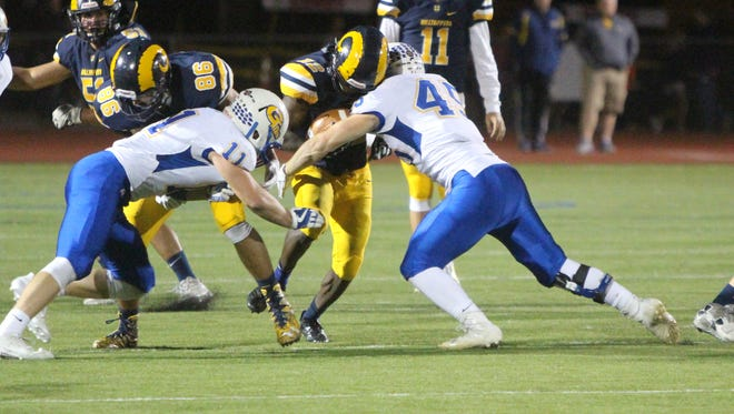 Callan Stangler (45) makes a tackle for Germantown earlier this year.