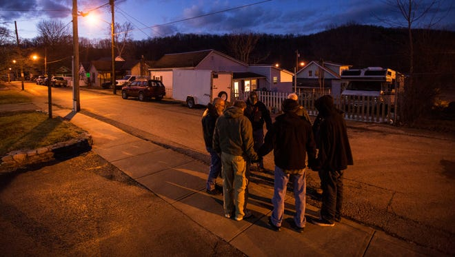 Feb. 4, 2016: On a Thursday evening, Rev. Darrell Breeden leads a weekly prayer group around the town of Butler, Kentucky, which is racked with heroin.