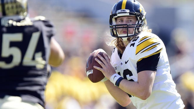 The long hair is gone, but C.J. Beathard's arm remains a focal point of Iowa's offense in 2015.