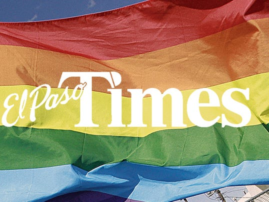 """MARK LAMBIEâ """"EL PASO TIMES  Sammy Lusher rides down N. Mesa Street Saturday morning as he participated in the El Paso Sun City Pridefest parade. Hundreds participated in the parade which is part of the larger festival."""