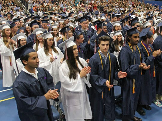 Graduates applaud one of the speakers during the Carmel