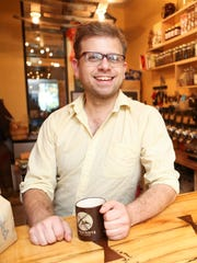 """Trevor DeCuir, co-owner at McQuixote Coffee located in Louisville's Tim Faulkner Gallery in the Portland neighborhood, sells Argo Sons coffee products, books, sandwiches and other items made from locally produced products. DeCuir began his coffee barista journey like most do, working part-time during college, but he had a special love for what coffee houses represent. """"I wanted to place just for people to... be,"""" DeCuir said. """"Every other business you go to you come for a purpose and then leave, but a coffee shop is a place you just go and hang out. You don't have any obligations."""" Oct. 29, 2015"""