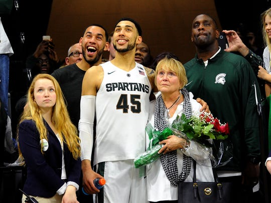 MSU senior Denzel Valentine stands with his family, from left to right, brother Drew, mother Kathy and father Carlton, as he is honored during senior day festivities after the Spartans' 91-76 win over Ohio State Saturday at Breslin Center.