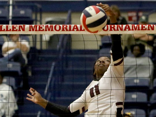 Vernon's Shykerra Fanner hits the ball over the net
