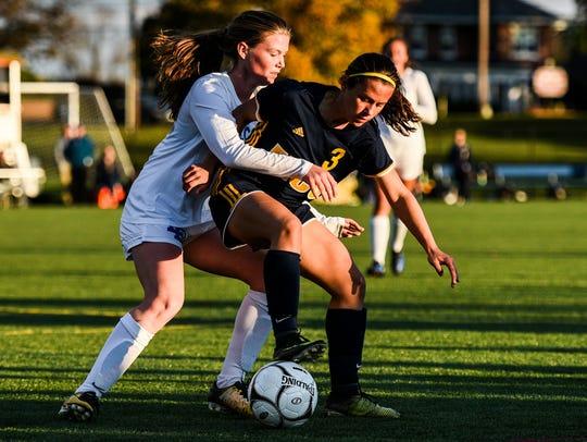 Elco's Katelyn Rueppel battles Lower Dauphin's Morgan