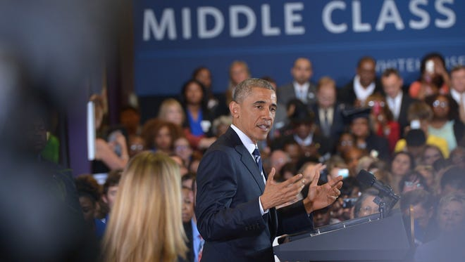 President Obama speaks during a town hall meeting April 15, 2015, on working families in Charlotte.