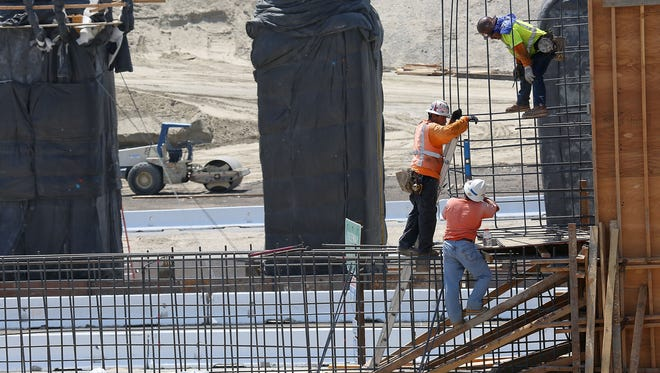 Crews work on construction of the new Jefferson St. interchange project in Indio, Thursday, August 20, 2015.  California's 50,000 miles of highways and nearly 13,000 bridges, consistently rank among the worst in the nation