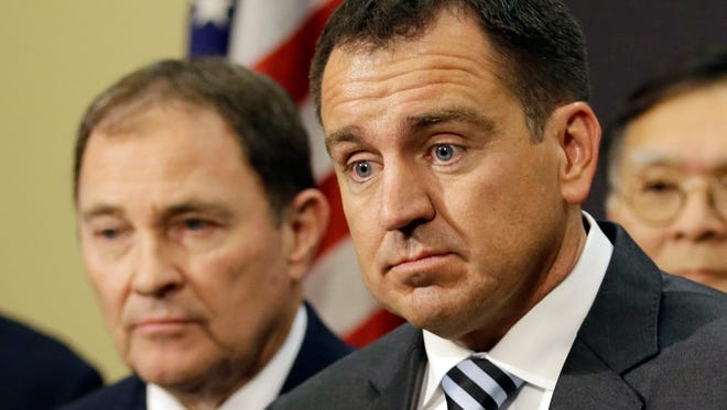 This March 12, 2015 file photo shows Utah House Speaker Greg Hughes, R-Draper, right, and Utah Gov. Gary Herbert at news conference in Salt Lake City. Utah's Republican-controlled Senate on Wednesday, March 3, 2016, narrowly passed a bill to abolish the death penalty in the conservative state, advancing what had been considered a longshot measure to the House. Sen. Steve Urquhart, the Republican lawmaker sponsoring the bill, says he thinks the bill will pass. The measure has the backing of Hughes, a Republican from Draper, but would then face likely opposition from Herbert, a supporter of capital punishment.
