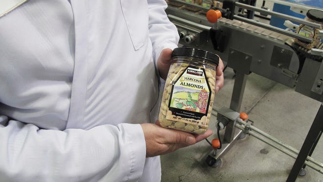 In this Monday, April 13, 2016 photo, Todd Crosswell, general manager of Caro Nut Co., holds a packaged jar of almonds at the company's nut processing plant in Fresno, Calif. Sophisticated thieves last year stole six truckloads from Caro Nut last year at a loss of $1.2 million to the firm. The scheme has cost the California nut industry nearly $7.6 million dollars in the last four years. In some cases, the thieves with international ties use fake shipping papers to assume the identity of legitimate firms to steal truckloads worth between $150,000 and $500,000 each.