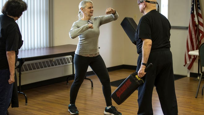Doria Dalo of Toms River works on defense maneuvers during the class. Walter Miller is the instructor of a self-defense course for Berkeley Township Recreation Department that helps senior citizens learn to defend themselves in the event of an emergency. 