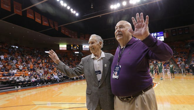 El Paso Times long-time sports writer Bill Knight and Ray Sanchez were honored during a timeout Saturday during the UTEP vs. Charlotte basketball game at the Don Haskins Center.