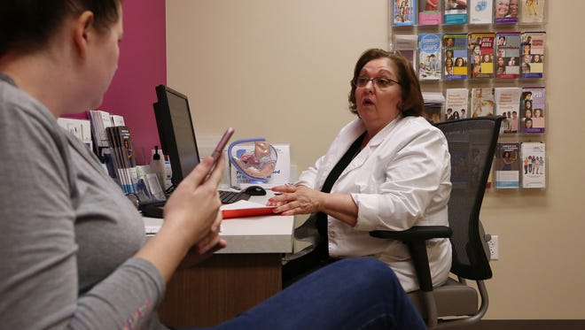 Vivian Bigelow, a nurse practitioner, discusses birth control options with a patient at a Planned Parenthood health center in Plano, Texas. The Republican healthcare plans would prohibit Medicaid recipients from using their benefits at Planned Parent facilities for one year. (Katie Falkenberg/Los Angeles Times/TNS)