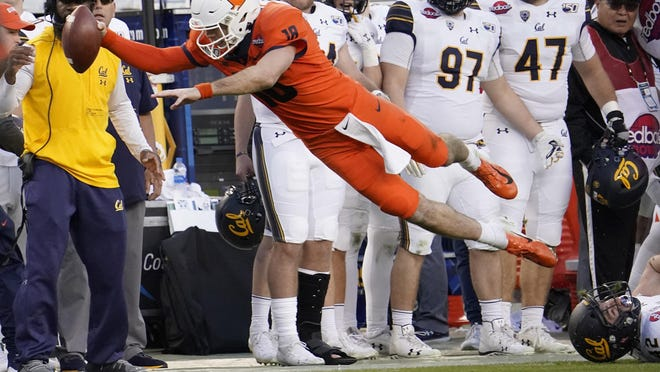 In this Monday, Dec. 30, 2019, file photo, Illinois quarterback Brandon Peters (18) dives for a first down against California during the second half of the Redbox Bowl NCAA college football game, in Santa Clara, Calif. Peters was short of the first down. Illinois appears poised to make a statement in the Big Ten during the 2020 season. One reason is quarterback Peters, who started after transferring from Michigan. He is Illinois' first returning No. 1 quarterback since 2016.