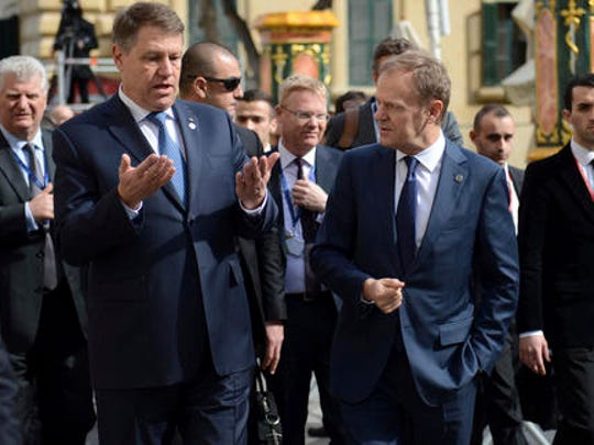 Romanian President Klaus Werner Iohannis, center left, speaks with European Council President Donald Tusk, center right, as he walks with other EU leaders during an event at an EU summit in Valletta, Malta, on Friday, Feb. 3, 2017. European Union heads of state and government gathered Friday for a one day summit to discuss migration and the future of the EU.