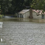 A residence near Bayou Des Cannes in Eunice is partially submerged due to recent flooding.