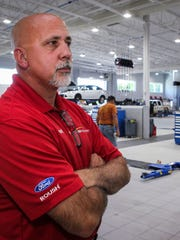 """Ford of Murfreesboro's service department more than doubled in size to 46 bays. """"David Lee want it to look world class, down to the toolboxes,"""" said Frank Bowie, pictured here, service department manager."""