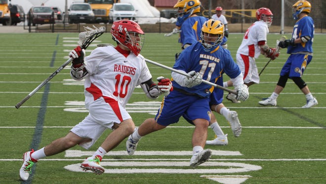 North Rockland's Kyle Michella moves the ball around Mahopac's Michael Longo during their game at Torne Valley Field in Hillburn, March 27, 2014. North Rockland beat Mahopac 7-6.
