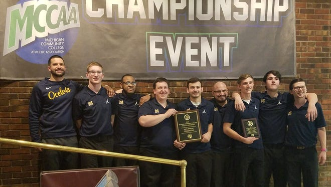 Schoolcraft College's men's bowling team celebrates its regional championship Feb. 16. From left are head coach Patrick Yelsik, Jared Stevens, Denzel Rice, Matt Gury, Cody Farr, Mike Rees, Richie Taylor, Mike Pizzuti and Ian Casmier.