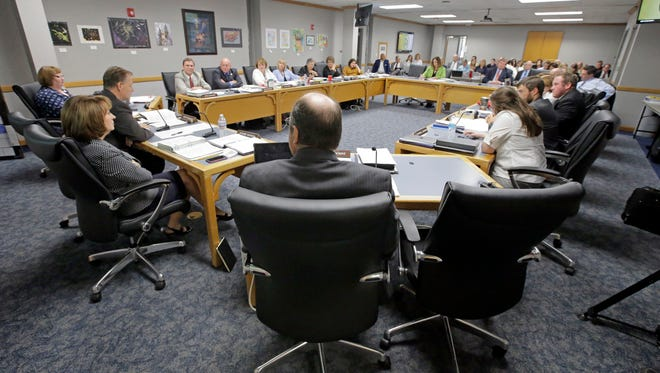 Members listen during Utah State Board of Education meeting Friday, Aug. 12, 2016, in Salt Lake City.