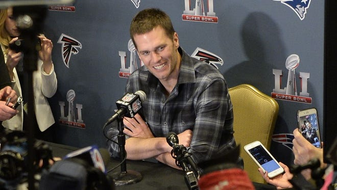 Patriots QB Tom Brady meets with reporters at the Super Bowl on Tuesday.