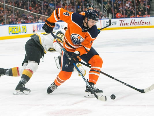 Vegas Golden Knights' Erik Haula (56) looks for the puck against Edmonton Oilers' Kris Russell (4) during first-period NHL hockey game action in Edmonton, Alberta, Thursday, April 5, 2018. (Amber Bracken/The Canadian Press via AP)