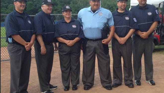 Steinrich, pictured third from the left, worked behind home plate for Saturday's Senior Little League World Series championship game in Bangor, Maine
