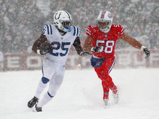 Buffalo Bills linebacker Matt Milano, right, chases Indianapolis Colts running back Marlon Mack during the first half of an NFL football game, Sunday, Dec. 10, 2017, in Orchard Park, N.Y. (AP Photo/Jeffrey T. Barnes)