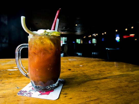 A Bloody Mary at Rusty's Backwater Saloon in Stevens Point, Wis., is topped with a meat stick, string cheese, and vegetables.