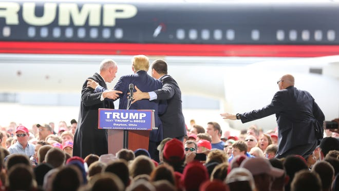 A scare for secret service and Donald Trump, Republican presidential candidate, as someone jumped a barrier and tried to rush the stage. The person was tackled and taken into a cop car, according to Nathan Speelman Dayton K-9 police officer. Trump was holding a rally at the Dayton International Airport.